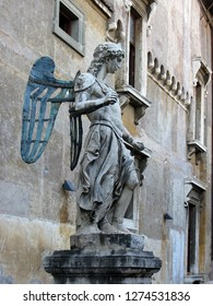 Castel Sant'Angelo, Rome, the statue of St. Michael the Archangel in the courtyard. A beautiful statue of an angel made of copper and stone.