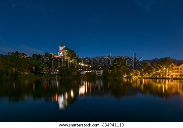Castel Werdenberg by night with reflection in the lake
