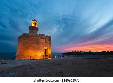 Castell de Sant Nicolau at Ciutadella, Menorca, on a beautiful sunset