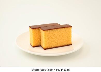 castella japanese sponge cake on plate on white background