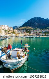 Castellammare del Golfo, Italy - August 7, 2017: Fishing port with old wooden fishing boats docked at the marina in summer in Castellammare del Golfo in Sicily, Italy