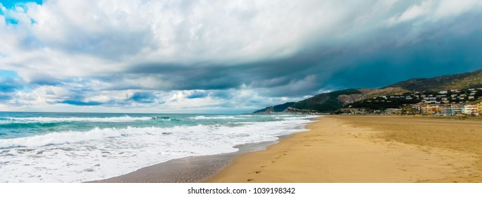 Castelldefels beach after a stormy day. The beach is especially beautiful with all the clouds and highlighting the colors