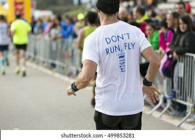 CASTELLDEFELS, SPAIN - OCTOBER 2016 - XII Marato del Mediterrani. Runners on the city streets on Oct 12, 2016 in Castelldefels, Spain