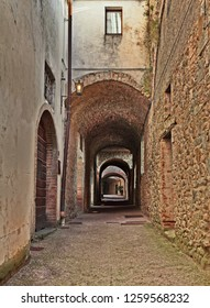 Castellina in Chianti, Siena, Tuscany, Italy: the ancient covered street Via delle Volte, a medieval narrow alley in the old town
