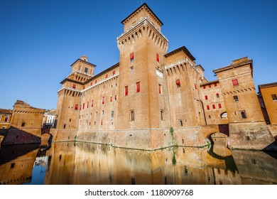 The Castello Estense in Ferrara in Italy. Moated medieval castle in the center of Ferrara, northern Italy. It consists of a large block with four corner towers.