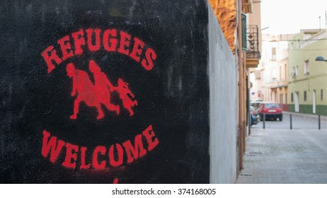 CASTELLON, SPAIN - 2016: graffiti welcome refugees in Castellon