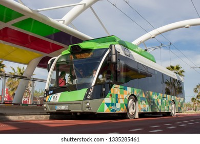 CASTELLON, SPAIN - 2019: Passengers boarding the electric bus known as TRAM.