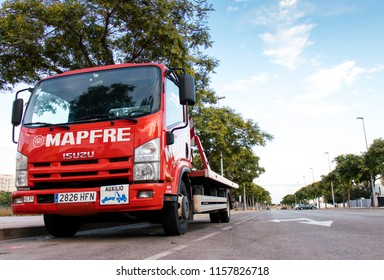CASTELLON, SPAIN - AUGUST 2018 - Truck crane service assistance road Mapfre company parked in one of the streets of the city.