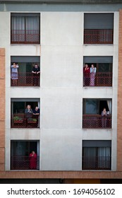 CASTELLON, SPAIN - MARCH, 2020: Homebound people clapping on balconies in support of health workers during the Coronavirus pandemic