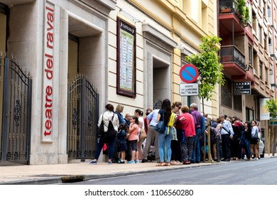 CASTELLON, SPAIN - MAY 2018: Several people queue at the entrance of the Raval theater.