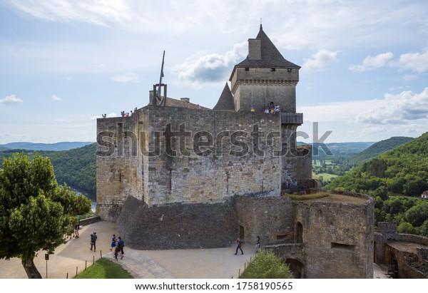 Castelnaud, Dordogne, France - August 13, 2019: People visiting Castelnaud-la-chapelle castle in Dordogne valley, Perigord Noir, France