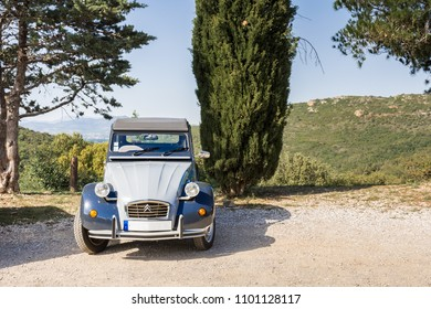 Castelnou, Pyrenees-Orientales, France - April 14 2017: A Citroen 2CV is parked in the French countryside