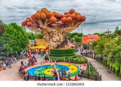 CASTELNUOVO DEL GARDA, ITALY - MAY 1: Giant tree inside Gardaland Amusement Park, near Lake Garda, Italy, May 1, 2018. The park attracts nearly 3 million visitors every year