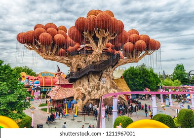 CASTELNUOVO DEL GARDA, ITALY - MAY 1: Giant tree inside Gardaland Amusement Park, near Lake Garda, Italy, May 1, 2018. The park attracts nearly 3 million visitors every year