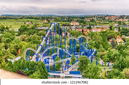 CASTELNUOVO DEL GARDA, ITALY - MAY 1: Rollercoaster inside Gardaland Amusement Park, near Lake Garda, Italy, May 1, 2018. The park attracts nearly 3 million visitors every year