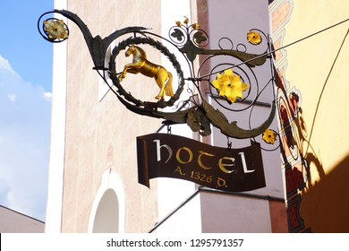 CASTELROTTO, ITALY - JUL 23, 2018 - Golden horse sign advertises its hotel in Castelrotto - Kastelruth, Italy