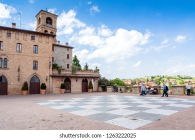 Castelvetro, Italy  - April 25, 2017: day view of main square and medieval buildings in Castelvetro di Modena, Italy. Castelvetro is known for its 6 medial towers and balsamic vinegar production.