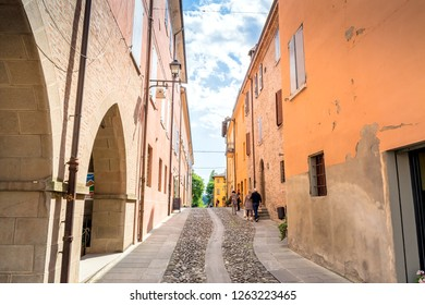 Castelvetro, Italy  - April 25, 2017: street view with unidentified tourists in Castelvetro di Modena, Italy. Castelvetro is known for its 6 medial towers and balsamic vinegar production.