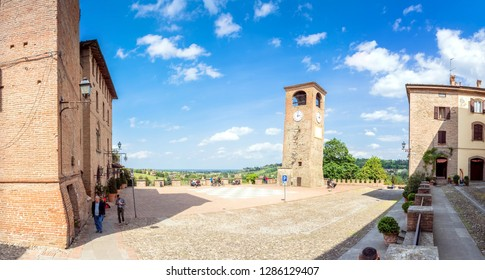 Castelvetro, Italy  - April 25, 2017: day view of main square and medieval buildings in Castelvetro di Modena, Italy. Castelvetro is known for its 6 medial towers and balsamic vinegar production