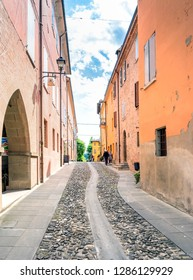 Castelvetro, Italy  - April 25, 2017: street view with unidentified tourists in Castelvetro di Modena, Italy. Castelvetro is known for its 6 medial towers and balsamic vinegar production