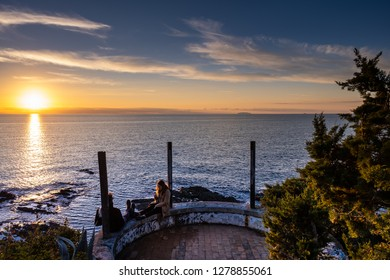 CASTIGLIONCELLO, ITALY - JANUARY 01, 2019: Two unknown people and Panoramic view on sunset, Castiglioncello, Livorno municipality, Tuscany