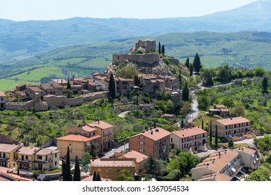 Castiglione d'Orcia, Italy - April 26, 2018: Amazing panoramic view of the Castiglione d'Orcia. Beautiful landscape in Tuscany. Fortress on the hill. The small typical town in Val d'Orcia