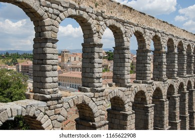 Castile and Leon, Spain - january 20, 2009: View of a central area of the city of Segovia, between the arches of the aqueduct