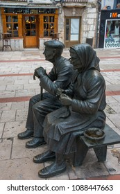 Castilla, Spain - march 07, 2018: Sculpture depicting an elderly couple sitting on a bench in a pedestrian street in the historic city of Burgos