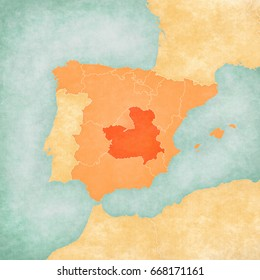 Castilla-La Mancha (Spain) on the map of Iberian Peninsula in soft grunge and vintage style on old paper.
