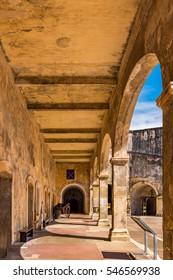 Castillo de San Cristobal corridor with arches and a wagon barrel