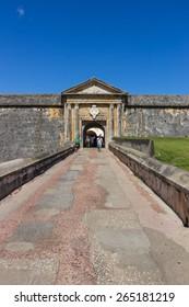 CASTILLO DE SAN FELIPE DEL MORRO, PUERTO RICO, USA - FEB 16, 2015: Visitors walk across the stone bridge that is the entrance of the fortress.
