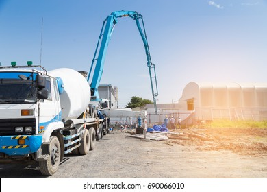Casting concrete slab by Hydraulic Pump machine with blue sky background,Construction work.