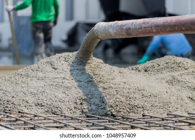Casting Concrete slab work with worker by pump tube,Construction work.