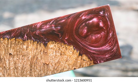 casting epoxy resin burl wood red violet background