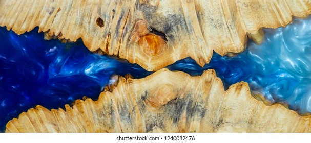 casting epoxy resin Stabilizing Afzelia burl exotic wood blue background texture, Abstract art picture photo, print design and your advertisement, hybrid