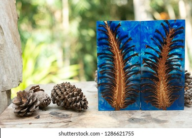 casting epoxy resin Stabilizing pine cone red blue abstract art blur background