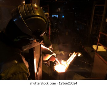 casting iron to a furnace