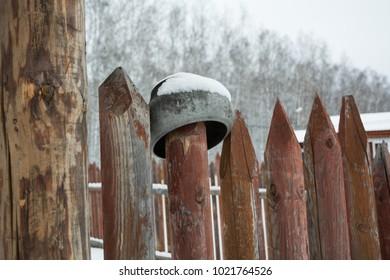 cast-iron pot on the fence
