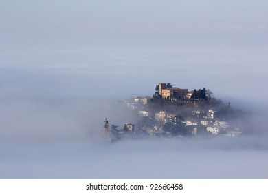 A castle above the clouds. Italy, Oltrepo Pavese, Mornico Losana. A village with castle that emerges from the fog.