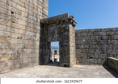 The Castle of Belmonte with stone walls and engravings under a blue sky and sunlight in Portugal