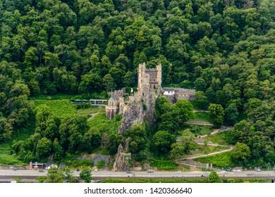 Castle Burg Rheinstein by Assmanshausen in the upper middle Rhine river valley (Mittelrhein), nearby Rudesheim, Bingen. Assmanshausen, Hessen, Germany. Unesco