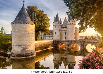 Castle or chateau of Sully-sur-Loire at sunset, France. This old castle is a famous landmark in France. Beautiful sunny view of the French castle on the water. Fairytale medieval castle in summer.