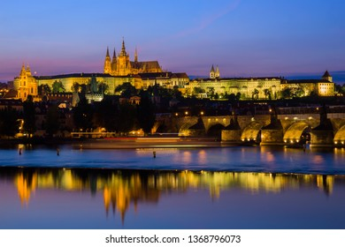 The Castle in city of Prague at dusk with reflection in Vltava river, Czechia (Czech Republic).