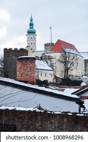 castle / clock tower in the town Mikulov covered in snow and ice with beautiful dramatic cloudy sky , South moravia , czech republic europe moravian touristic destination
