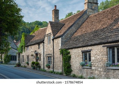 CASTLE COMBE, COTSWOLDS, UK - MAY 26, 2018:  Typical and picturesque English countryside cottages in Castle Combe Village, Cotswolds, Wiltshire, England - UK