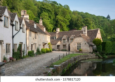 CASTLE COMBE, COTSWOLDS, UK - MAY 26, 2018: Street view of old riverside cottages in the picturesque Castle Combe Village, Cotswolds, Wiltshire, England - UK