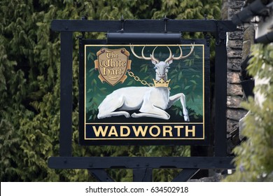 CASTLE COMBE, UK - MAY 1, 2017: The White Hart Wadworth Pub sign in Castle Combe, Wiltshire, UK