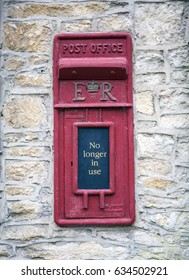 CASTLE COMBE, UK - MAY 5, 2017: Main street in Castle Combe, Wiltshire, UK,  showing old disused post office box