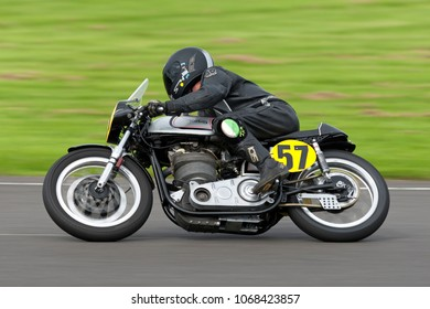 Castle Combe, Wiltshire, UK - August 17, 2008: A 1962 Norton Manx 499cc Motorcycle rides around a race track