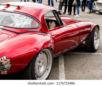 Castle Combe, Wiltshire, UK Sept 2018. aguar E-Type with a 1JZ engine swap, drift car in red, classic, isolated